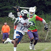 Lacrosse : My family is lacrosse crazy. My brothers and I played lacrosse in high school and I played  in college. My son, Michael, started playing as an infant, as soon as he could walk, and continued through to college. When he graduated from high school he had 62 different college coaches trying to recruit him to their schools. He was also an excellent student and ended up playing his college lacrosse at Swarthmore College, a top ranked academic institution. Mike was an Academic All American at the attack position and I can tell you that watching him play has been one of my life's greatest pleasures. I now have several nephews playing the game and I greatly enjoy watching their games. Most of the photos in this gallery are from their games. Just to show you how lacrosse crazy we are, my seven month old granddaughter owns two lacrosse sticks, although she is not yet an expert in their use. Something to look forward to!!